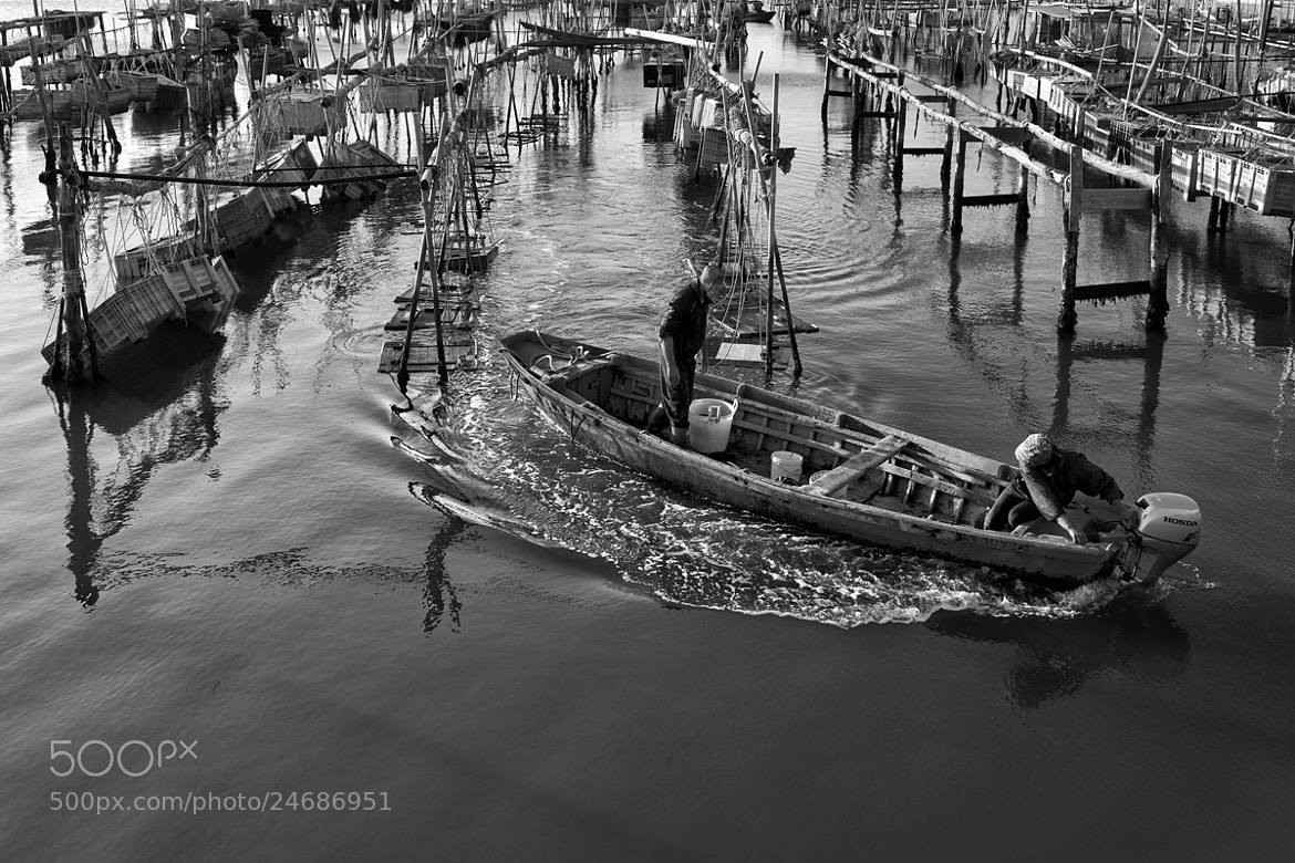 Photograph Fishermen of  lagoon by Carlo Tardani on 500px