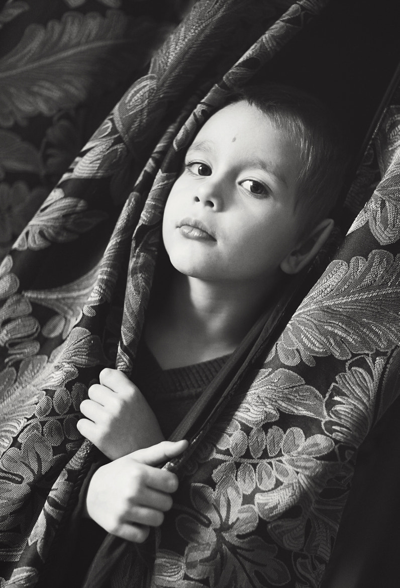 Photograph Boy who grew up out of curtains with ear like a bud by Lena K. on 500px