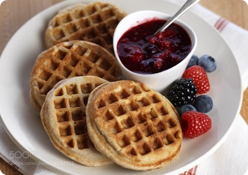Photograph Driscoll's® Whole Wheat Almond Waffles with Mixed Berry Sauce by Driscoll's Berries on 500px