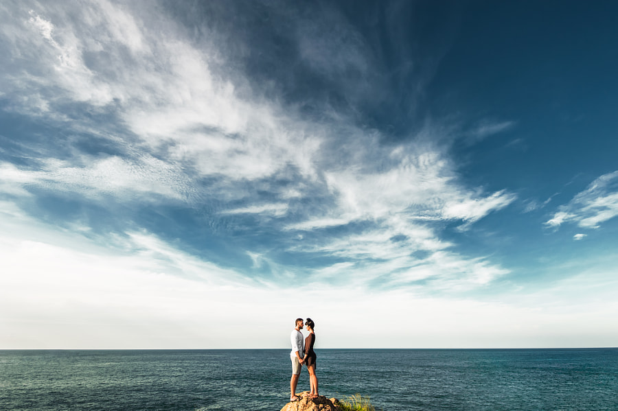 Couple poses - Lonely couple on a cliff by the sea by MISHA SOTNIKOV on 500px.com
