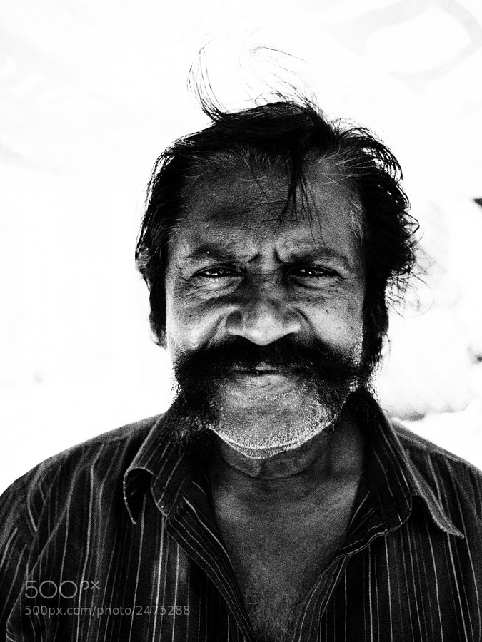 A friendly Indian food seller in Penang, Malaysia.