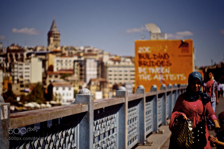 Photograph lady on bridge by Kaisa Heikkila on 500px