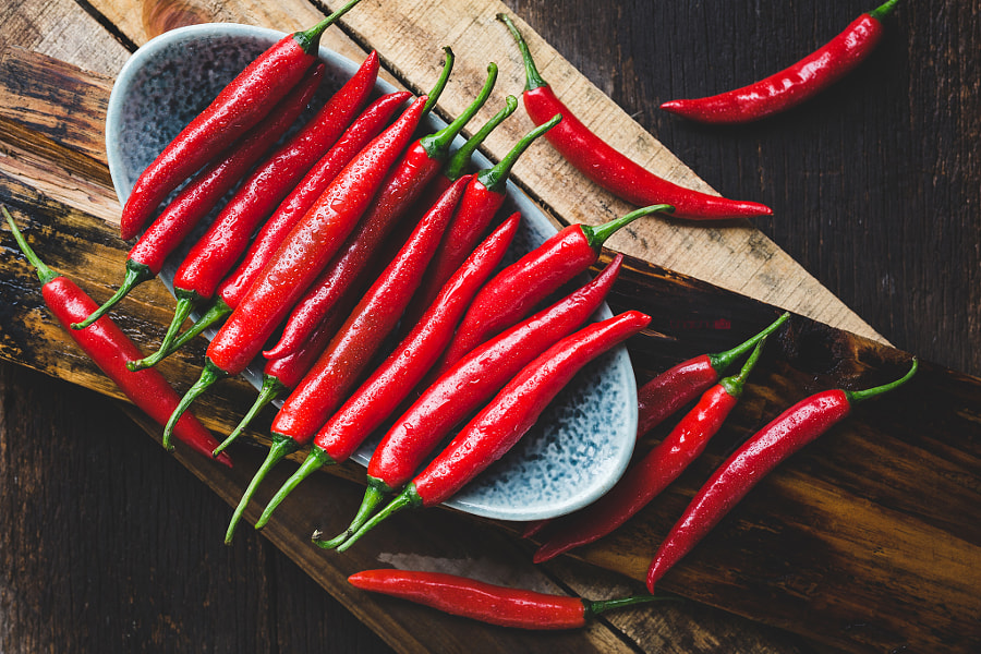 Red chillis on the old wood by Thai Thu on 500px.com