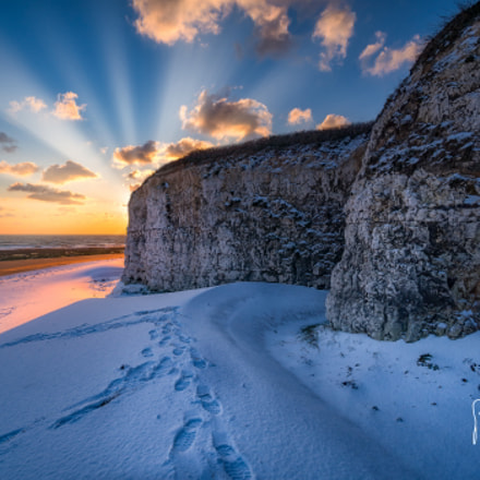 Sunrise on snow covered beach