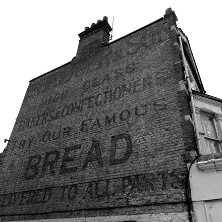 Old shop wall sign, Canon IXUS 275 HS