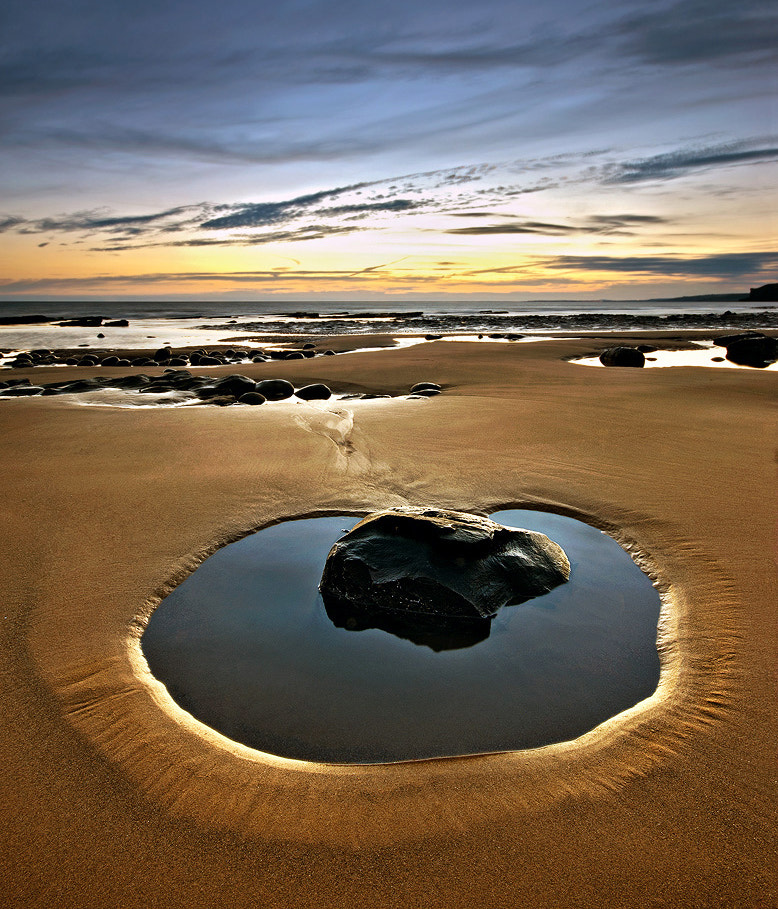 Photograph Rock in a puddle by Geoffrey Baker on 500px