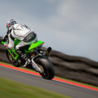 Julien Da Costa fires his MSS Kawasaki ZX-10R out of Brittens's chicane and accelerates hard as he starts the climb towards Hilltop at Oulton Park race circuit. Keeping the front wheel on the ground on one of these powerful BSB motorcycles is a hard task as depicted here. At this point in time man and machine are in close proximity to 120mph and will hit 160mph before grabbing the brakes. An awesome spectacle to behold.