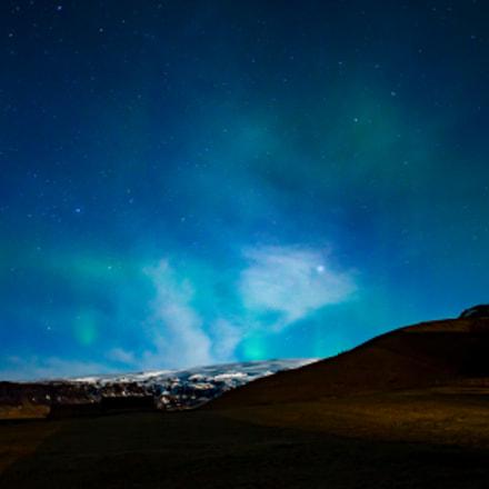 Light Aurora over Snow Capped Peak