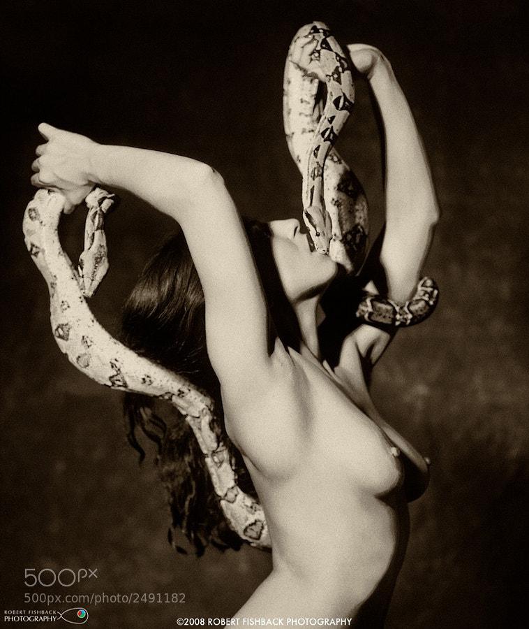 Nude girl dances with snake