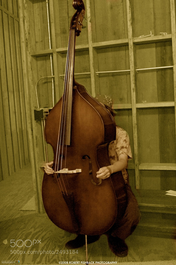 Bass player waiting to get on stage at a Bluegrass festival