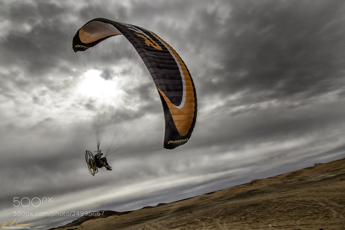 Photograph Paragliding At Red Sands by Jared Crean on 500px