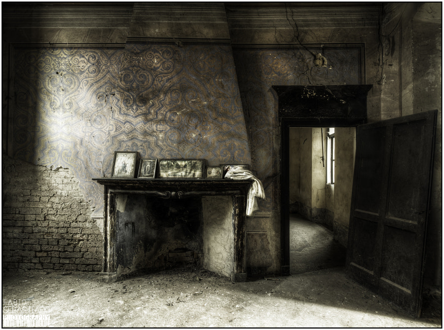 The room with the fireplace and sacred objects.