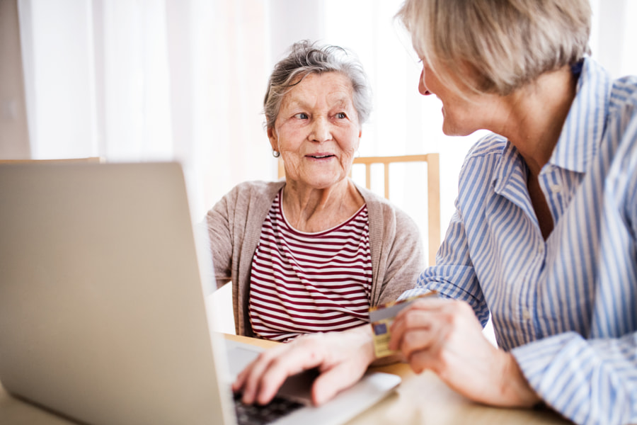 Senior woman with her mother with laptop at home. by Jozef Polc on 500px.com