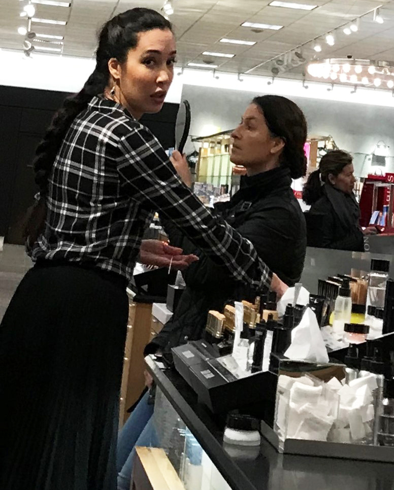 Cosmetic counter woman catches glimpse of Iphone