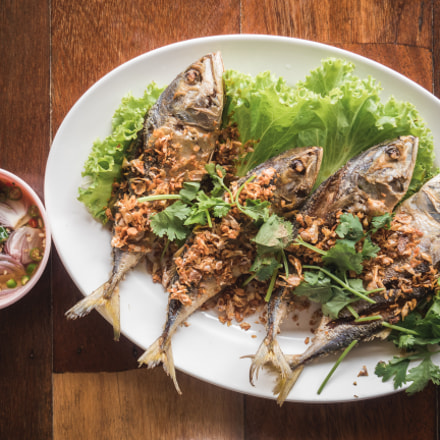 ASIAN FOOD : fried fish, Pla Too, with pepper and garlic and spicy sauce on wooden table
