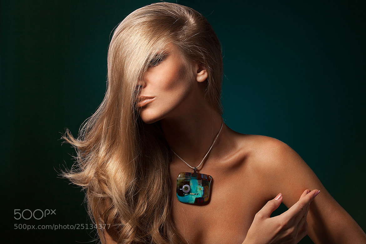Photograph blonde on a green background by Pavel Kolotenko on 500px