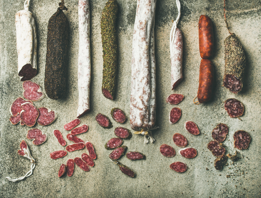 Variety of Spanish or Italian cured sausages cut in slices by Anna Ivanova on 500px.com