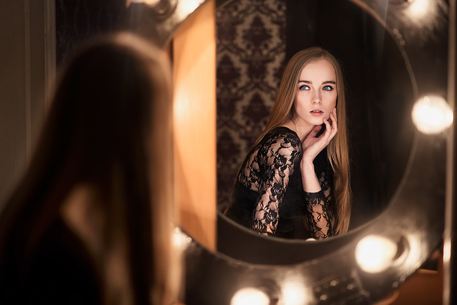 Beautiful fashion model woman posing near the mirror by Mykyta Starychenko on 500px.com