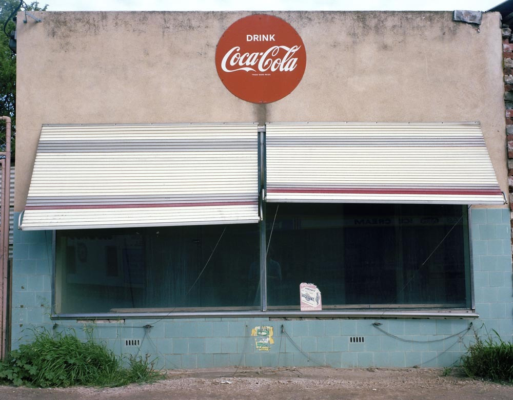 Photograph Old shop with Coke sign by Peter Fisher on 500px