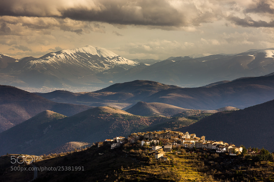 Abruzzo in Winter.  The village on the hilltop is Castelvecchio Calvisio and the photo was shot in late afternoon when the sun was just hitting the village.   This photo was shot on the way back from Sicily in February 2013. Yesterday on Feb. 6.