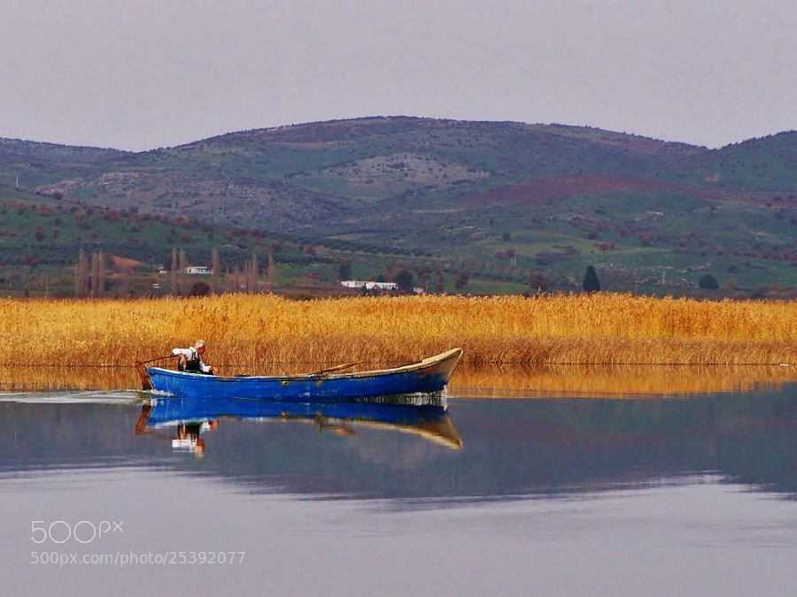 Photograph Boat on the lake by Metin Canbalaban on 500px