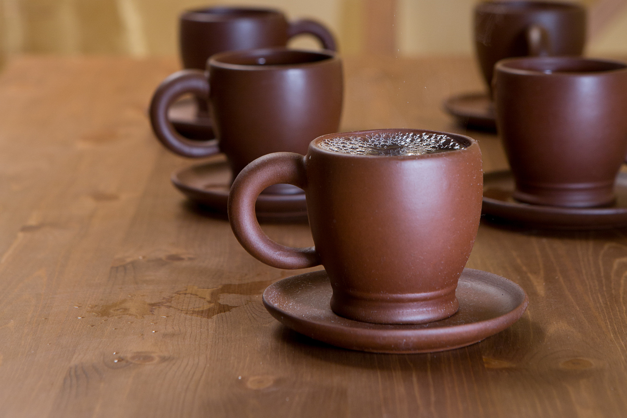 Photograph Clay cups on a wooden table by Ruslan Grigoriev on 500px