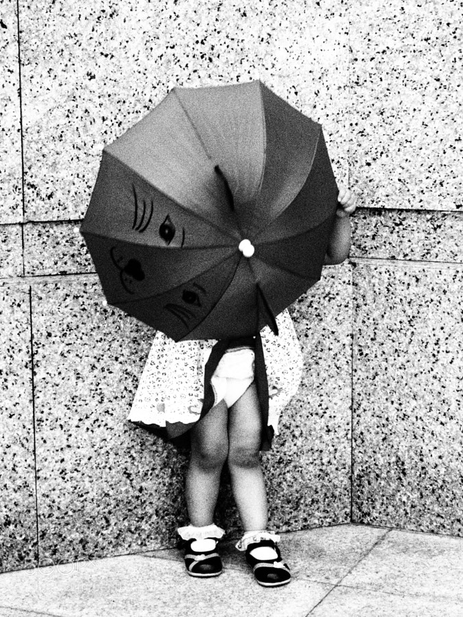 This cute little girl was playing with her small umbrella outside the mosque at Putrajaya, Kuala Lumpur, Malaysia.
