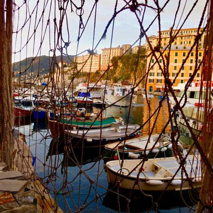 Boats through fishnets, Nikon COOLPIX S6200