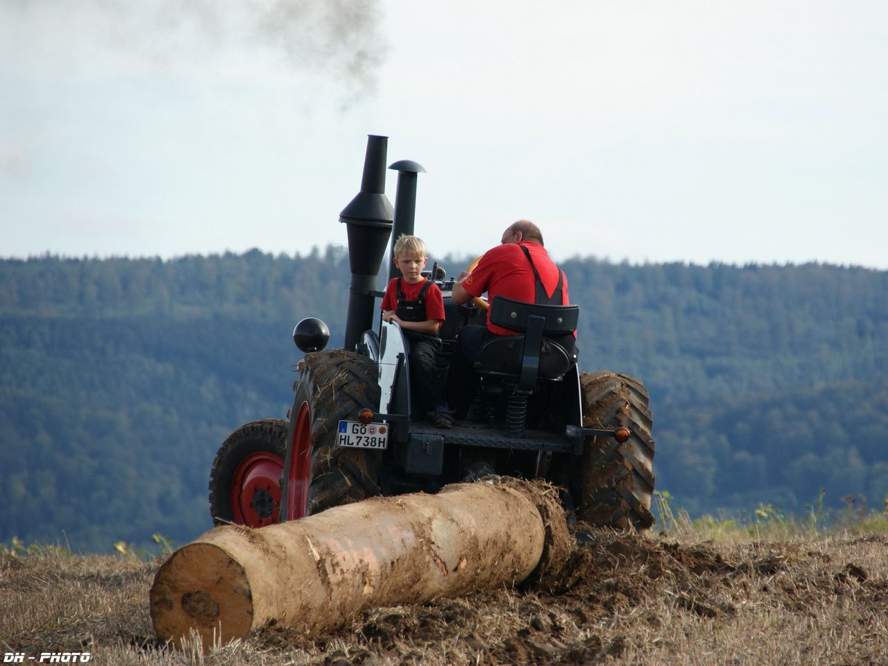 Photograph hard working with an old tractor and young copilot by Klaus Heinemann on 500px