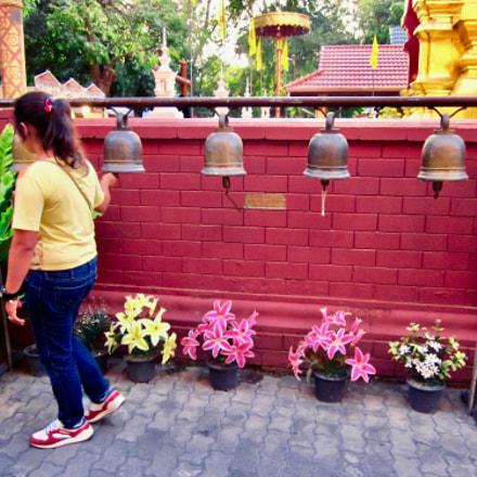 Woman ringing bells at, Canon IXUS 105