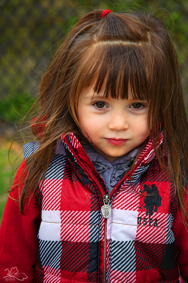 Child with red polo jacket