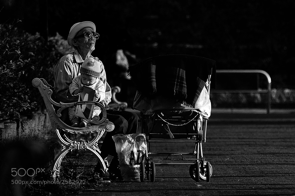 Photograph Old man and child by saint huang on 500px