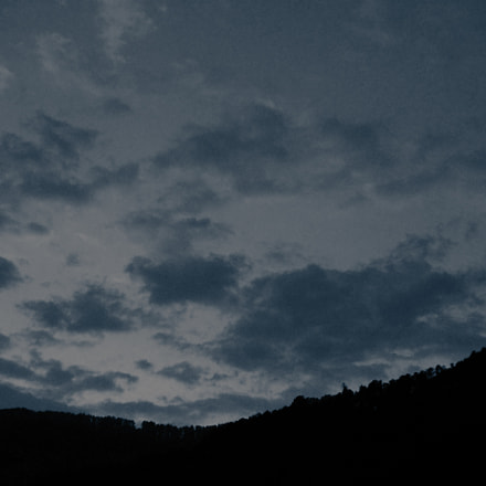 cloudy sunrise over forest, Nikon COOLPIX L28