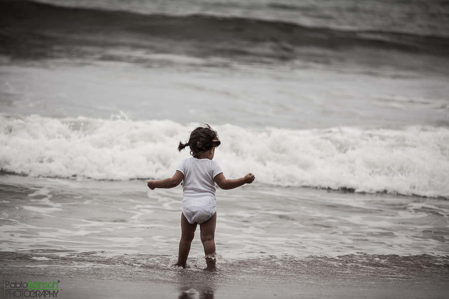 Playing on the shore.-