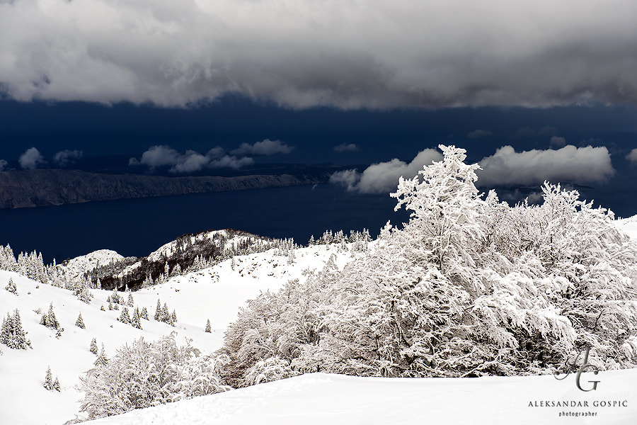 Storm from the Adriatic sea is approaching Zavižan on Velebit mountain and is about to bring heavy snowfall, down below Rab island is about to be swallowed