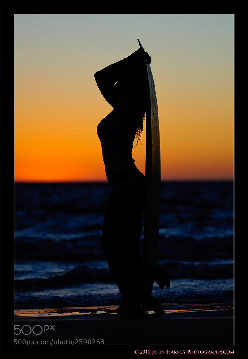 Photograph Sunset Surfer Girl by John Harney on 500px