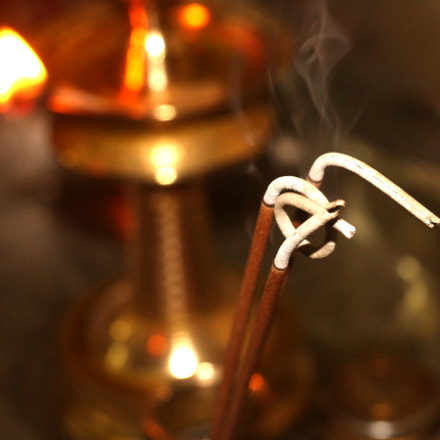incense sticks emitting smoke, Canon EOS 3000D