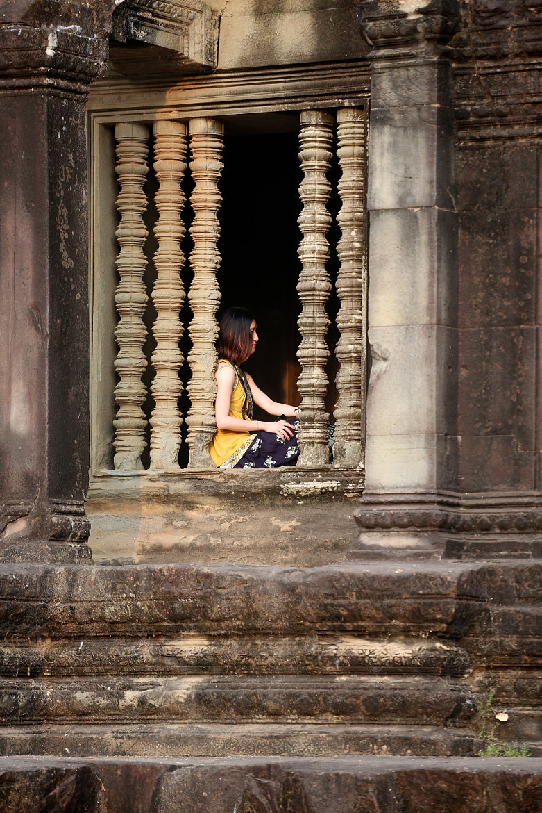 Photograph Girl in Angkor Wat window. by Nigel Paterson on 500px