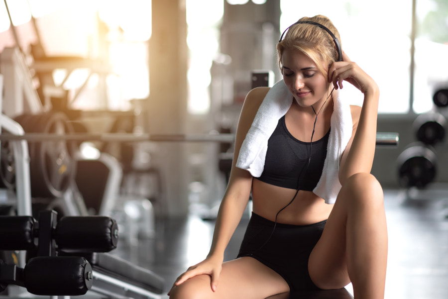 Athletic Woman Relax After Workout in Gym by Platoo Fotography on 500px.com