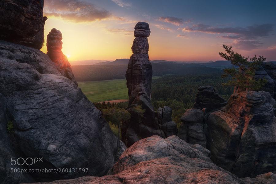 "Rising sun behind rock needle ""Barbarine"""