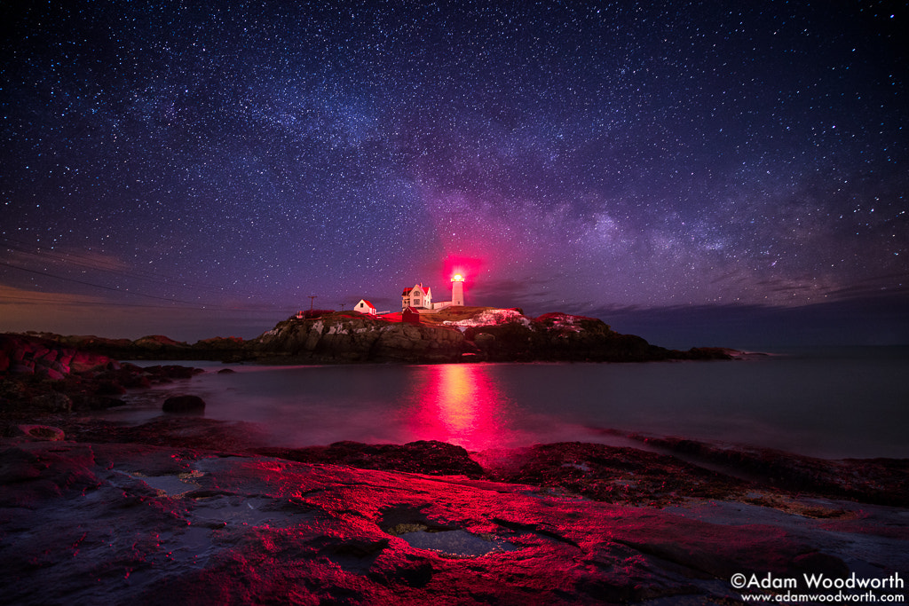Photograph Milky Way Over Nubble Lighthouse by Adam Woodworth on 500px