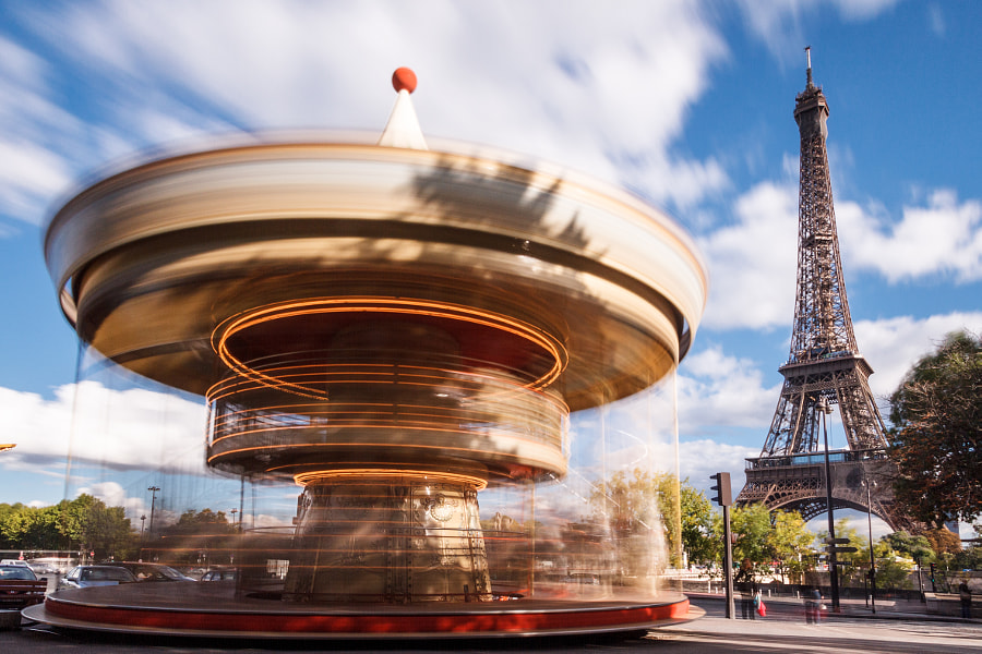 Spinning whirligig in Trocadéro with Eiffel Tower in the background.