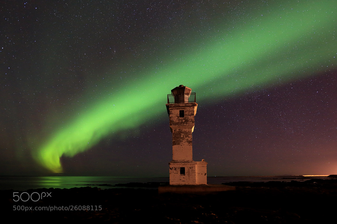 Photograph The Ray of Green light surrounding the lighthouse by Jon Hilmarsson on 500px