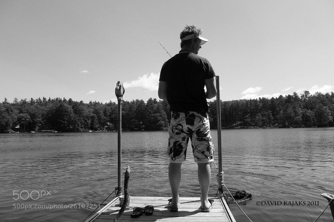 Photograph Fishing off the dock with my black labrador. by David Kajaks on 500px