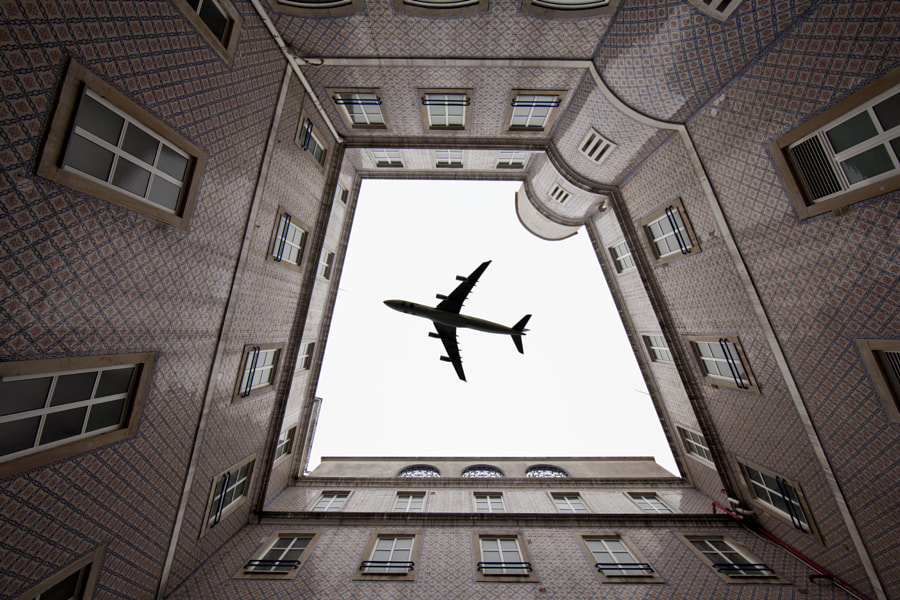 an airplane on the roof by Daniel Antunes on 500px.com