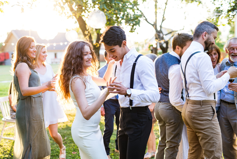 Wedding photography - Guests dancing at wedding reception outside in the backyard. by Jozef Polc on 500px.com