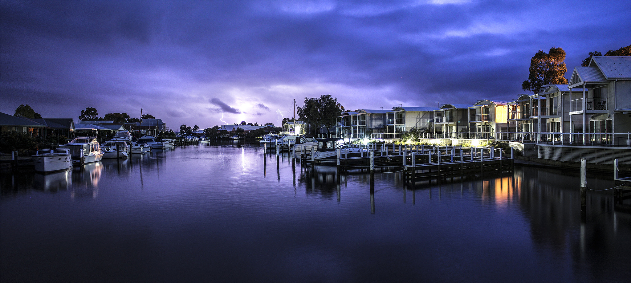 Photograph Lightning over Paynesville Canals by Ashley Davies on 500px
