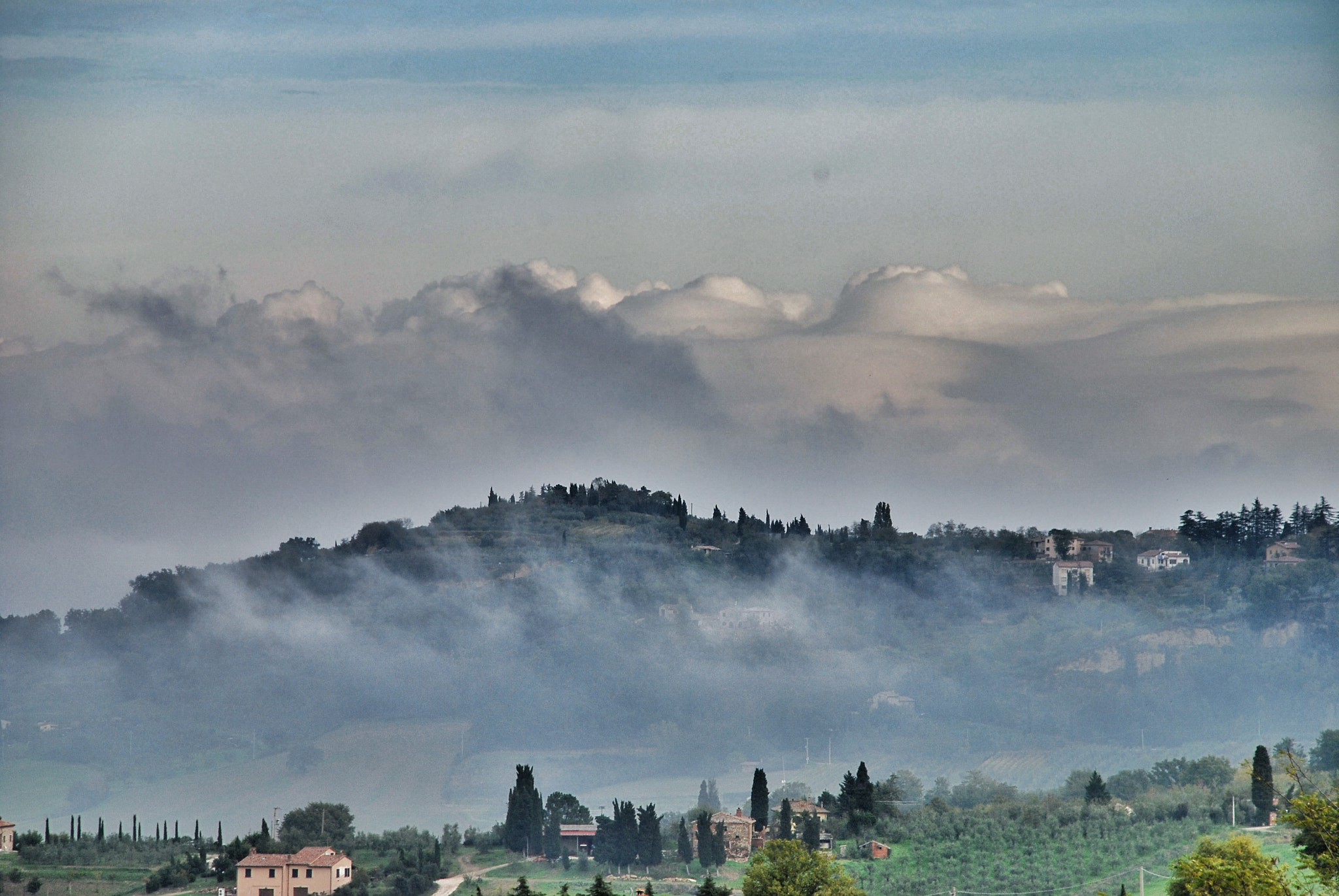 Photograph Clouds and fog in the morning in Montepulciano by luigibertagni on 500px