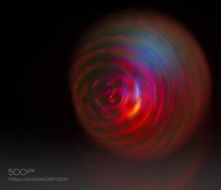 Child's toy ball, lit and spinning