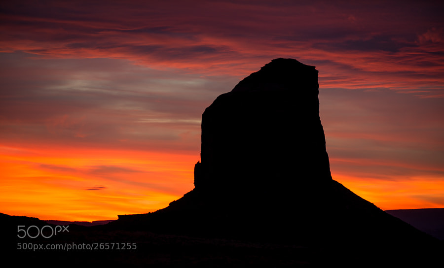 Mitchell Butte sunset in Monument Valley, Arizona. Nikon D3S, 1/15 @ f 4.